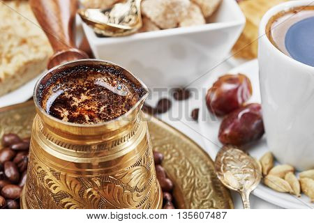 Traditional Turkish black coffee and sweet dainties