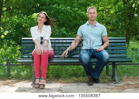 Young Shy Man Flirting With Woman In Park