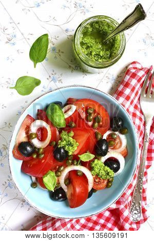 Tomato Salad With Capers,black Olives,onion And Sauce Pesto.