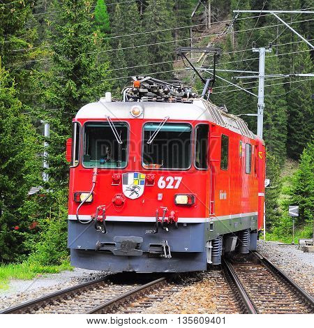 Litziruti Switzerland - June 07 2010: Passenger train to Arosa arrives to the station from Chur.