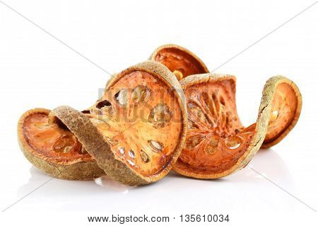 Bale Fruit dried tee. Isolated on white. Bale fruit is tropical fruit with hard exterior cover. The fruit has medicinal value for digestive system. Extensively consumed in rural India and Thailand.