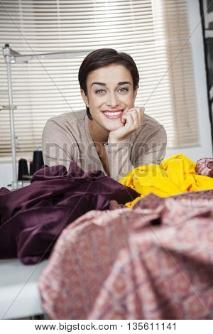 Happy Tailor Leaning On Workbench