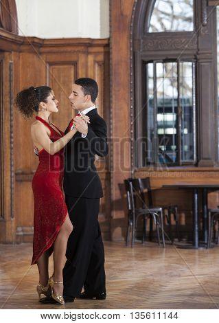 Dancers Performing On Hardwood Floor In Restaurant