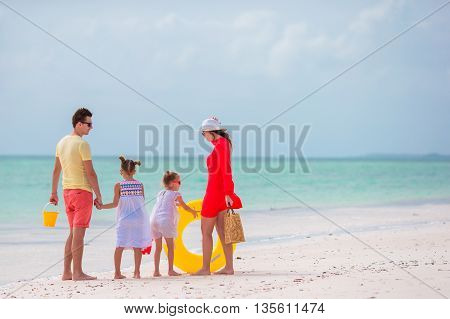 Young happy caucasian family on beach vacation