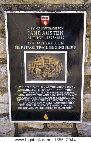 A plaque marking the nearby location where Jane Austen attended school in Southampton UK.