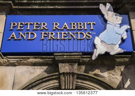 CUMBRIA UK - MAY 29TH 2016: A sign for the Peter Rabbit and Friends Gift Shop in Bowness-on-Windermere in the Lake District on 29th May 2016.