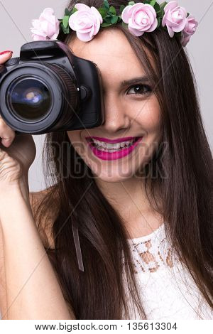Beautiful latina girl holding DSLR camera