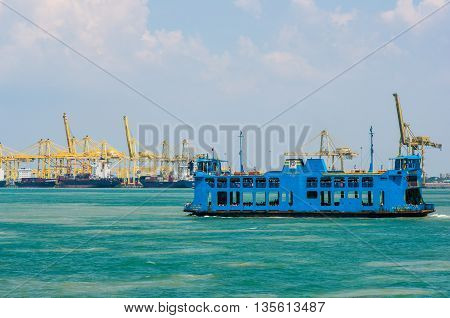 Georgetown, Penang, Malaysia - February 20, 2015: Ferry carrying passengers cruising between Malaysia mainland and Penang island, Malaysia.