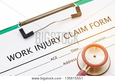 Claim form for an injury at work with stethoscope.