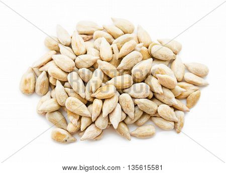 The Shelled Sunflower Seeds on White Background.