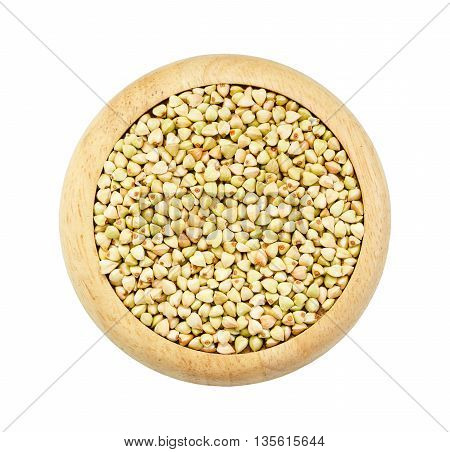 Buckwheat grains in wooden dish isolated on white background Saved clipping path.