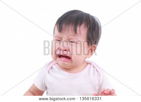 About to cry Asian baby girl isolated on white
