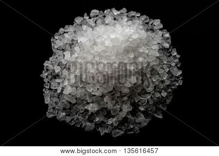 white crystals sea salt on black background top view