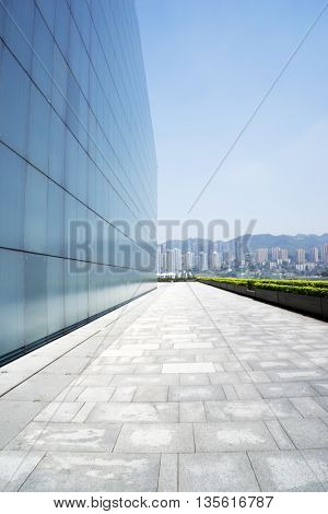 cityscape and skyline of chongqing on view from empty footpath near building
