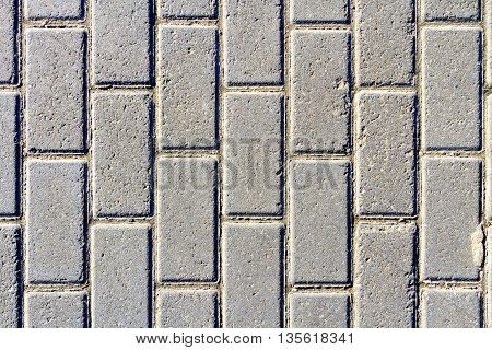Street with cement grey and square blocks