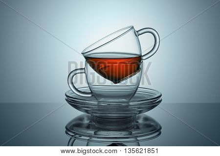 Two cups with saucers from transparent glass from the tea remains