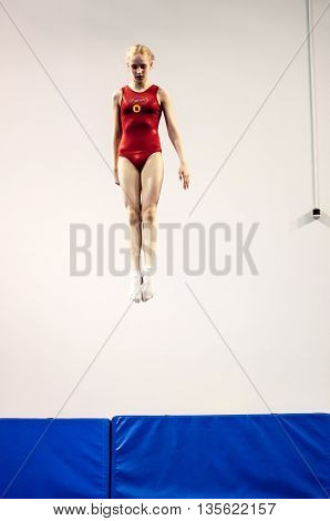 Orenburg, Russia - 19 April 2016: Girls Compete In Jumping On The Trampoline