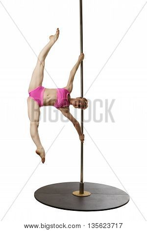 Smiling female gymnast poses during workout on pole
