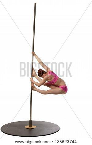 Pole dance. Image of redhead woman exercising on pylon