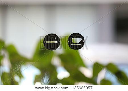 Drink coffee and Smoke zone logo on glass