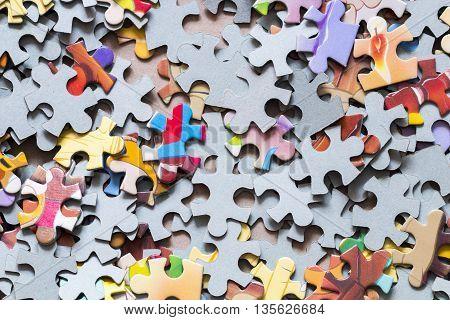 pieces of a colour puzzle close up background