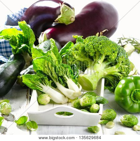 Fresh Green Vegetables On  Wooden Table.
