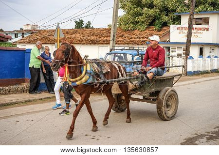 Trinidad Cuba - January 14 2016: Trinidad's residents still use horse-drawn carriages as the preferred vehicle. Cuba has one of lowest vehicle per capita rates in the world
