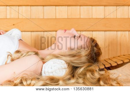 The Beautiful Blonde Has A Rest In A Hot Sauna Eyes Closed