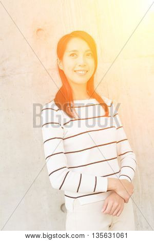 Young asian woman portrait against the wall
