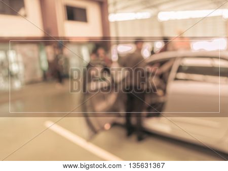 Blur Image Of Technician Fixing Car In Ther Garage.