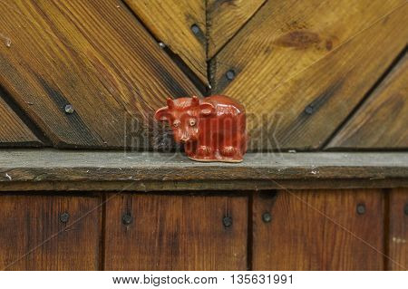 red bull toy on wood wall close up