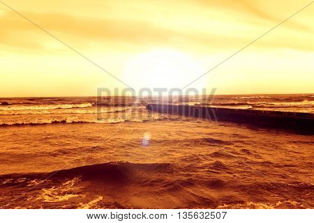 Beautiful red sunset at the seaside. Baltic sea, Poland