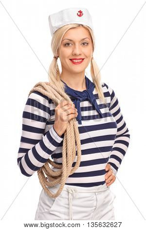 Vertical shot of a female sailor holding a rope and looking at the camera isolated on white background