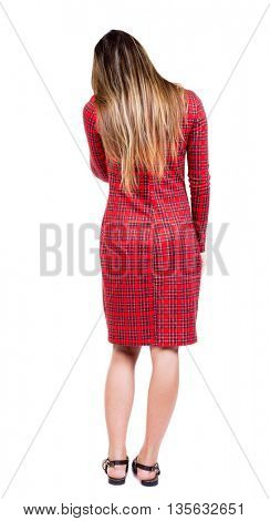 back view of standing young beautiful  woman.  girl  watching. Rear view people collection.  backside view of person.  Isolated over white background. The girl in red checkered tilted her head.