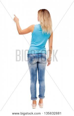 Back view of  pointing woman. beautiful girl. Rear view people collection.  backside view of person.  Isolated over white background. girl in jeans and a blue shirt shows a finger of his right hand