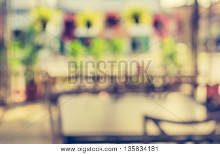Abstract Blurred Image Outdoor Table In Garden .