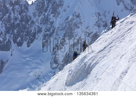 Chamonix-Mont-Blanc, France - May 20, 2016: Extreme Skiing area Vallee Blanchet at Aiguille de Midi (3842m) in the Mont Blanc Massif. They walk down to the start point for extreme back country skiing tours.