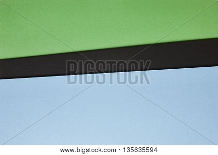 Colored cardboards background in green black blue tone. Copy space. Horizontal