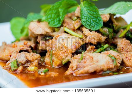 Hot and Spicy Grilled Pork Salad Nam Tok Moo Thailand food