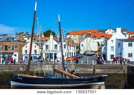 Anstruther Scotland - July 26 2012: Fife area yachts in the village harbor at low tide.