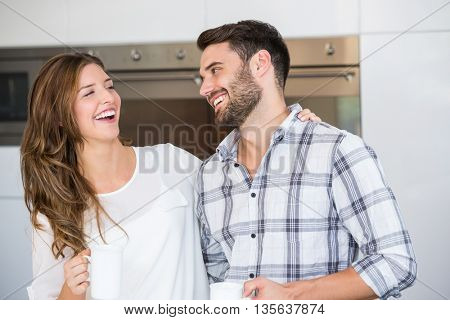 Close-up of cheerful young couple at home