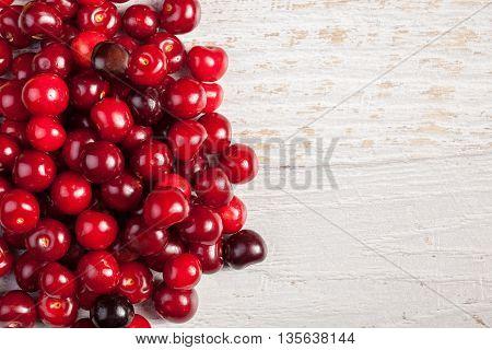 Juicy Fresh Cherry On Wooden Background