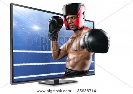 Boxer performing upright stance against composite image of boxing ring