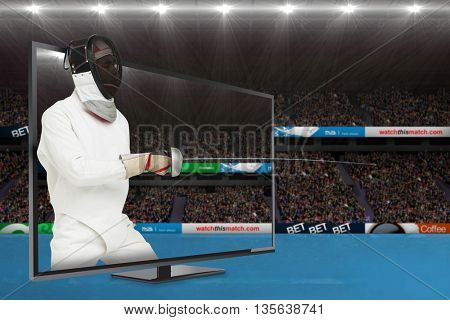 Man wearing fencing suit practicing with sword against view of a stadium