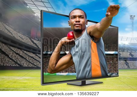 Front view of sportsman practising shot put against digital image of a stadium