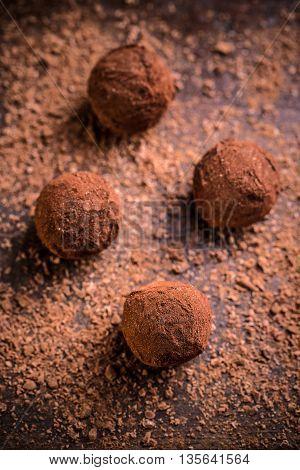 Chocolate truffles on dark background, studio shot