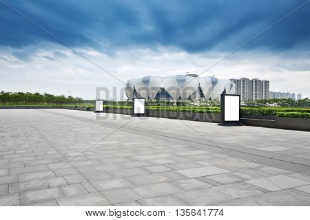 hangzhou,china:hangzhou new olympic stadium in cloud sky on view from empty marble floor by zhudifeng on Jun 4 2016
