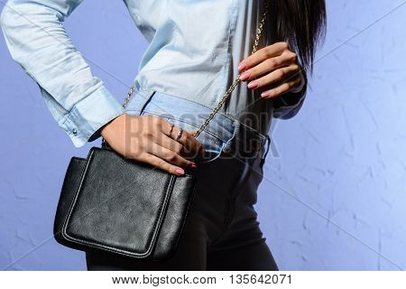 Stylish Woman In Jeans With Small Black Handbag Clutch.