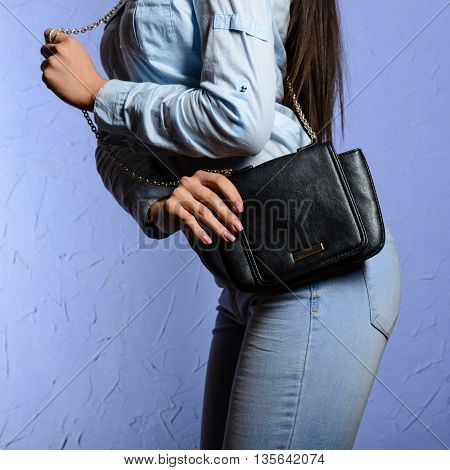 Fashionable Woman In Denim Shirt And Jeans With Black Bag