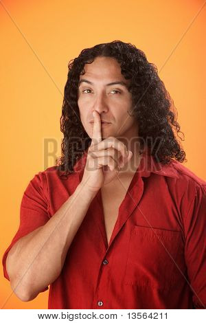 Man With Finger To His Lips